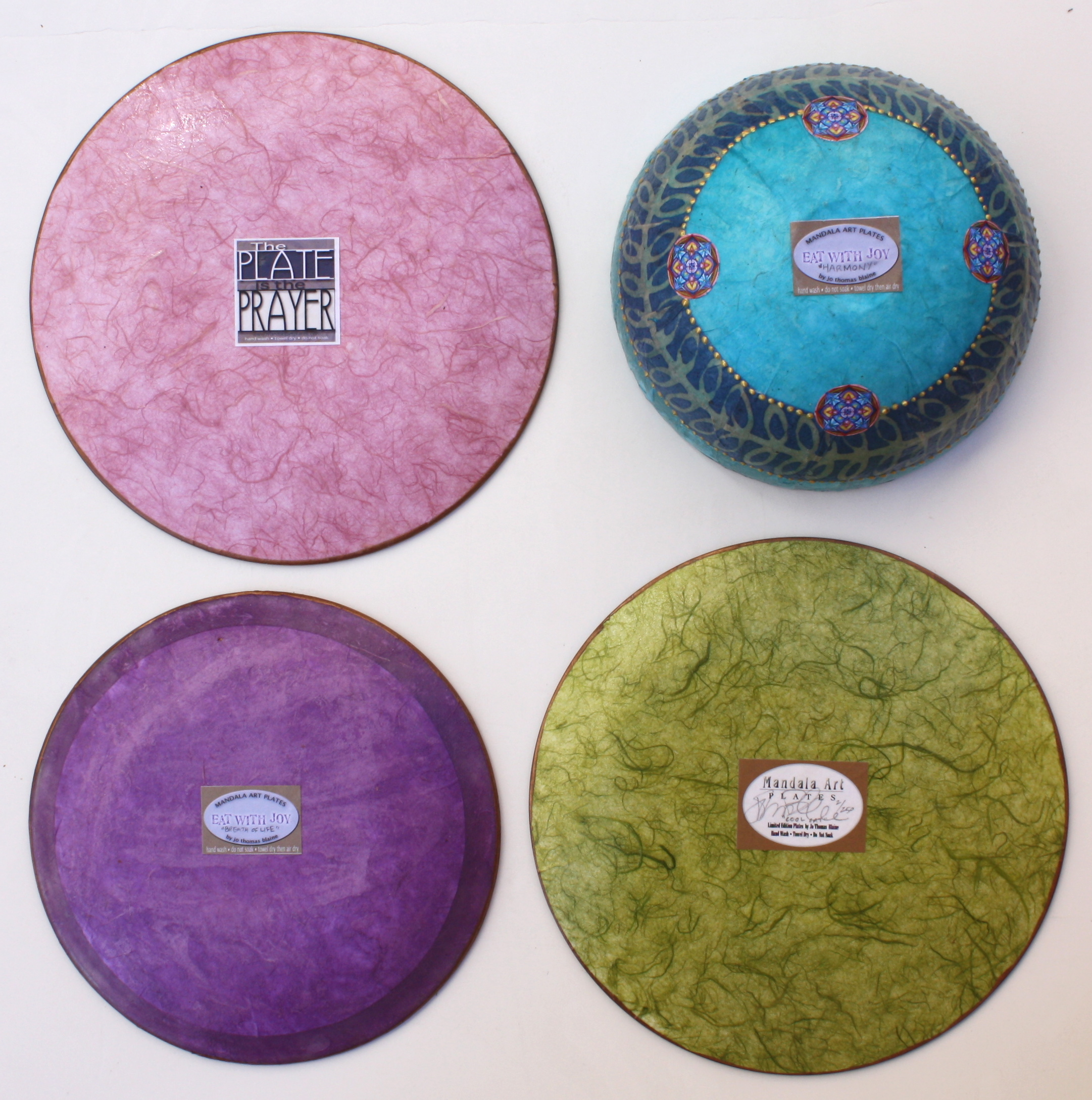 "clockwise from upper left: back of 10"", back of bowl, back of 10"", back of 9"""